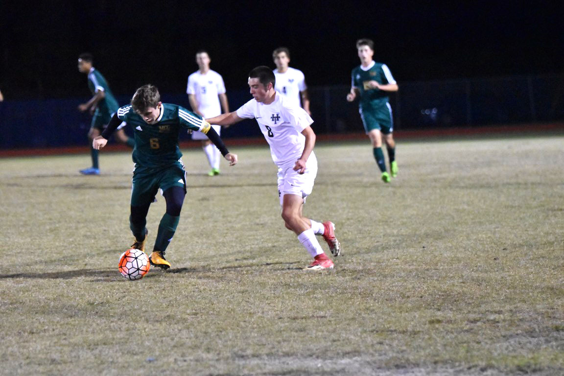 Captain Hunter Gaskin sprints down the field to assist senior Carlo Campinininini with the game wining goal.