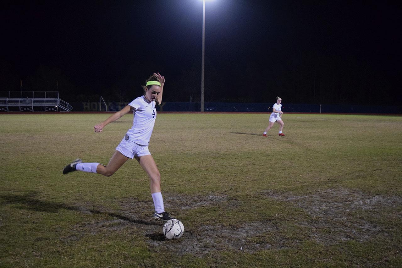 Sophomore Julia McCarthy attacks ball to score a goal.
