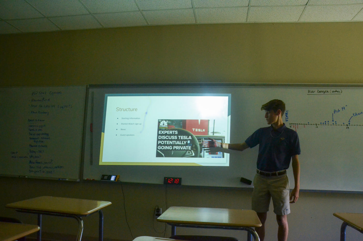 Edward Marr, President of the Stock Market Club, presents during the first meeting.