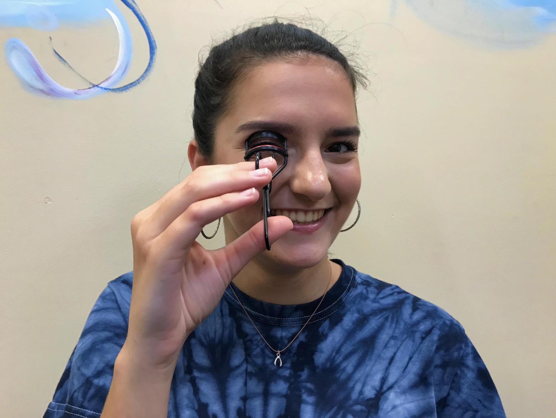 Sophomore, Emma Bishop, curls her eyelashes for good luck.