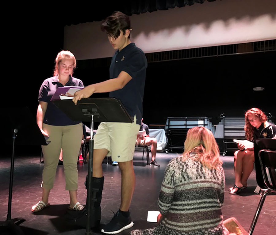 Students Chelsea Terry and Logan Mays rehearse for the fall show, guided  by drama teacher Ms. Meyer.