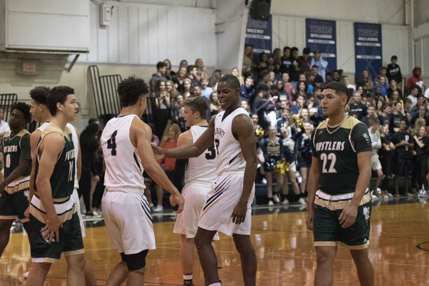 Seth Coleman and Dru Nickson congratulating each other during the game.