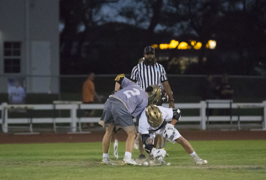 Junior Adam Cole on face off to get the ball on their side.