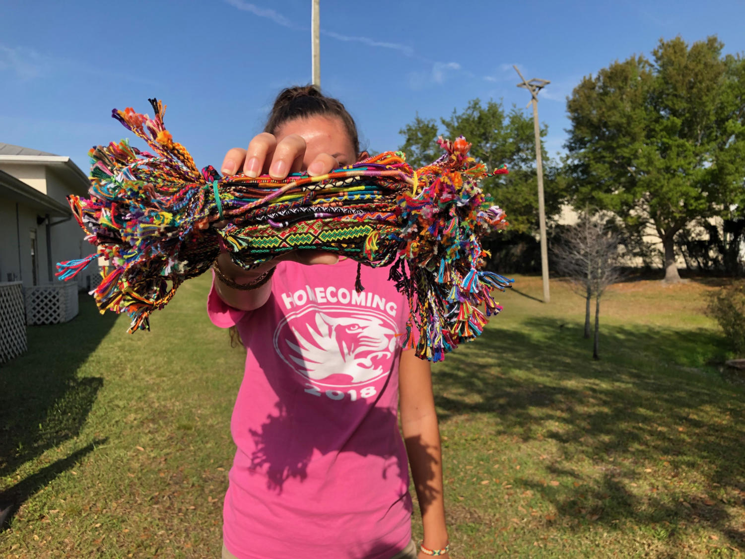 Sofia Obermaier holding some of the bracelets she is selling.