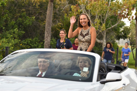 Grace Dance, homecoming queen nominee, riding down to the field before the game.