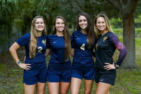 Girls soccer seniors (from left) Amelia Anello, Kailey Dunne, Julia McCarthy, and Payton Yates celebrated Senior Night this past Friday. The group hopes to lead the team on a lengthy postseason run in the coming weeks.