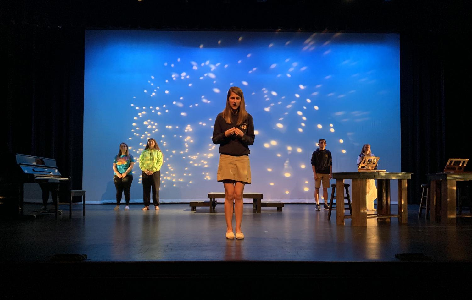 Senior Sarah Kimmerling delivers the show's final monologue during a Tech Week rehearsal. Kimmerling won Best Actress in the District at the District 11 One Acts Festival for her portrayal of Henrietta Leavitt.