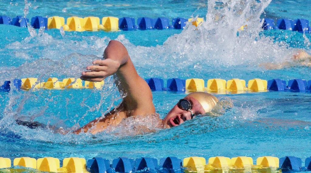 Sophomore Alex Spies competes for the Holy Trinity swim team. He and his sister Marissa are now focusing on their  club season.