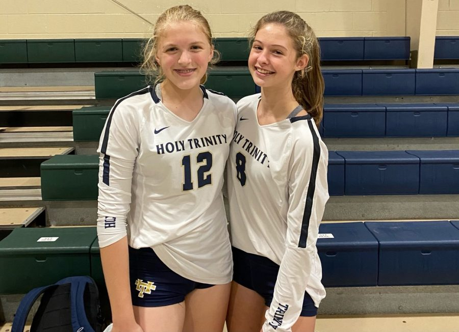 Eighth-grader Isabelle Clark, left, joined freshman Brianna Wakefield on this year's HT varsity volleyball team.