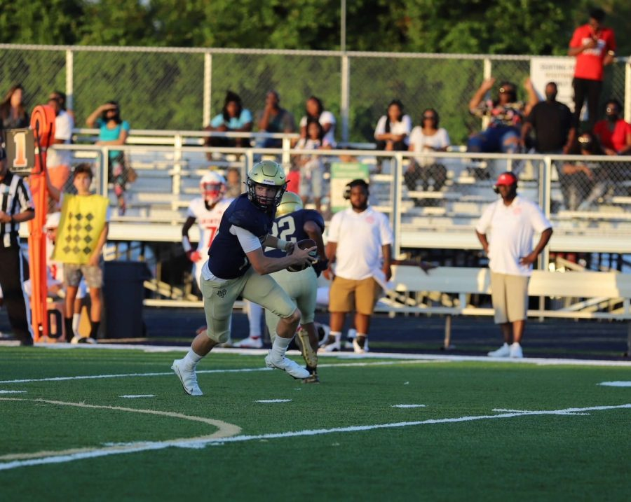 Quarterback Ty Englehart looks downfield as he rolls out of the pocket.