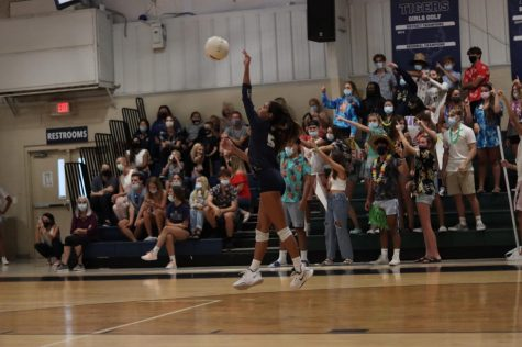 Maya Collins serves the ball during the first home game of the season against Viera